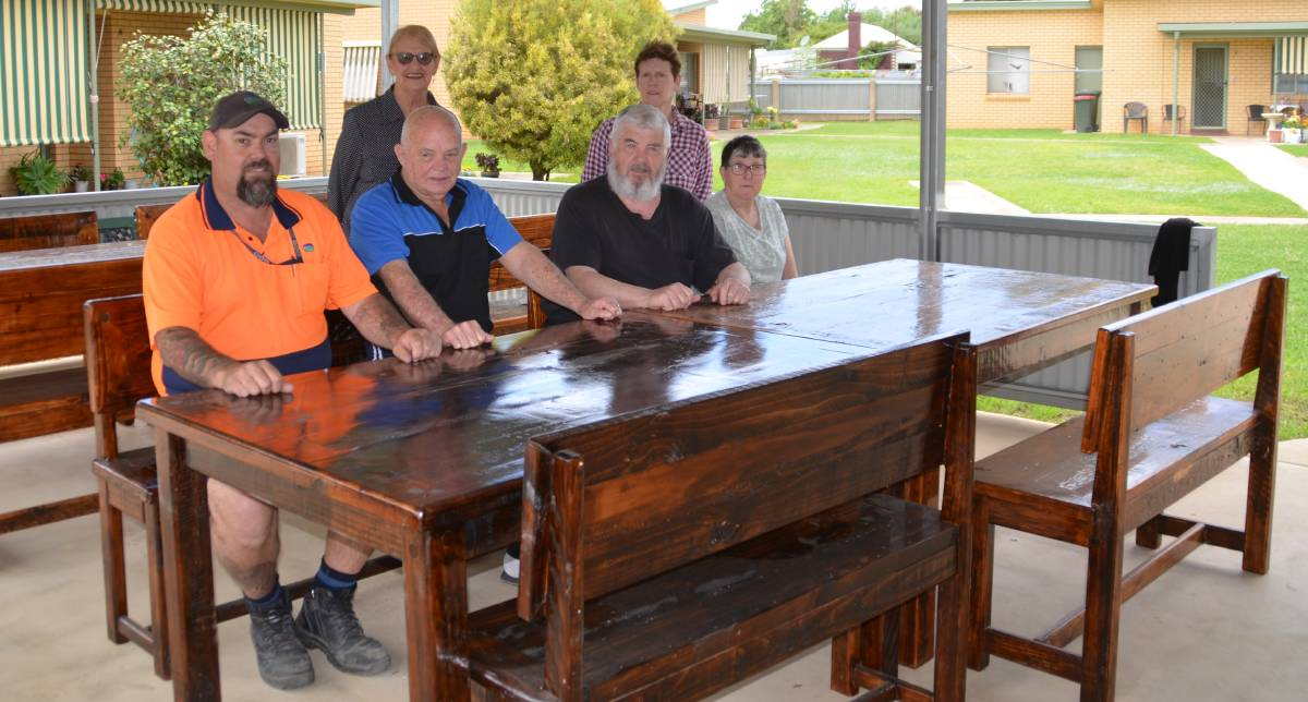 NEW GEAR: Junee Correctional Centre's industries manager Peter Holt was thrilled to pass on the new furniture to Lawson House, with Jim O'Regan, Barbara Wealands, Bill Richardson, Noreen Deacon and Catheryn Whiles pleased to accept it. Picture: Contributed
